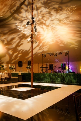 black and white dance floor in square pattern and patterned uplighting