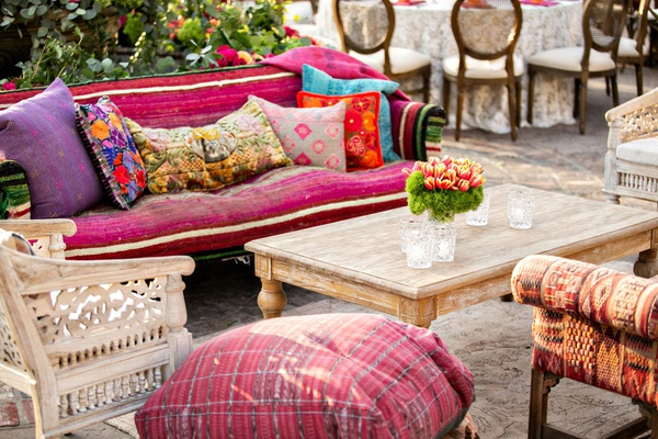 outdoor wedding reception lounge boho chic wood furniture pink purple floor pillow furnishings decor