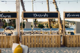 food stations on the beach for destination wedding in cabo san lucas