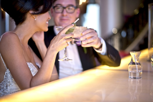 bride and groom enjoy a martini and cocktail before the wedding, pre-wedding cocktails