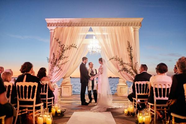 ca' d'van outdoor wedding ceremony at night overlooking sarasota bay