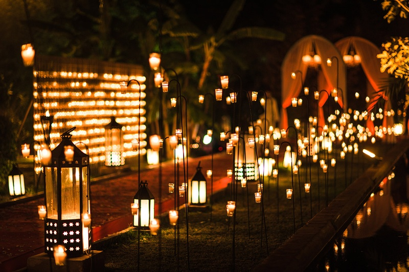 ceremony décor photos pathway lit with lanterns lights inside