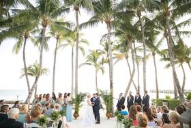 Wedding ceremony on the sand in Key West, Florida destination wedding venue ideas palm trees ocean