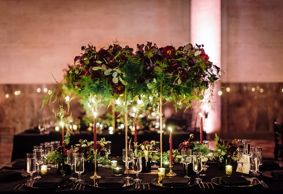 "Tall gold stand for ""floating"" centerpiece greenery, burgundy oxblod flowers, candlelight taper"