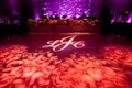 Red gobo lighting projection on wedding reception dance floor