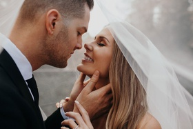 Suzanna Villarreal and Alex Wood LA Dodgers wedding portrait almost kiss under veil