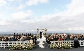 wedding ceremony overlooking los angeles california rustic wedding ceremony greenery pink flowers