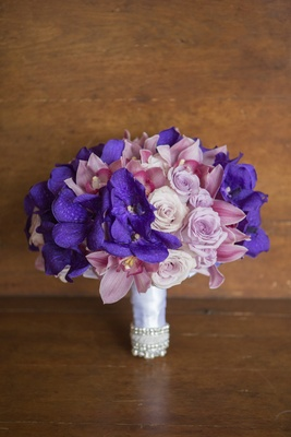 Violet and pink orchids and roses in ribbon