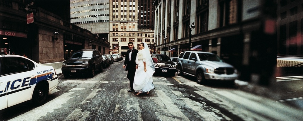 Bride and groom in wedding attire in the street