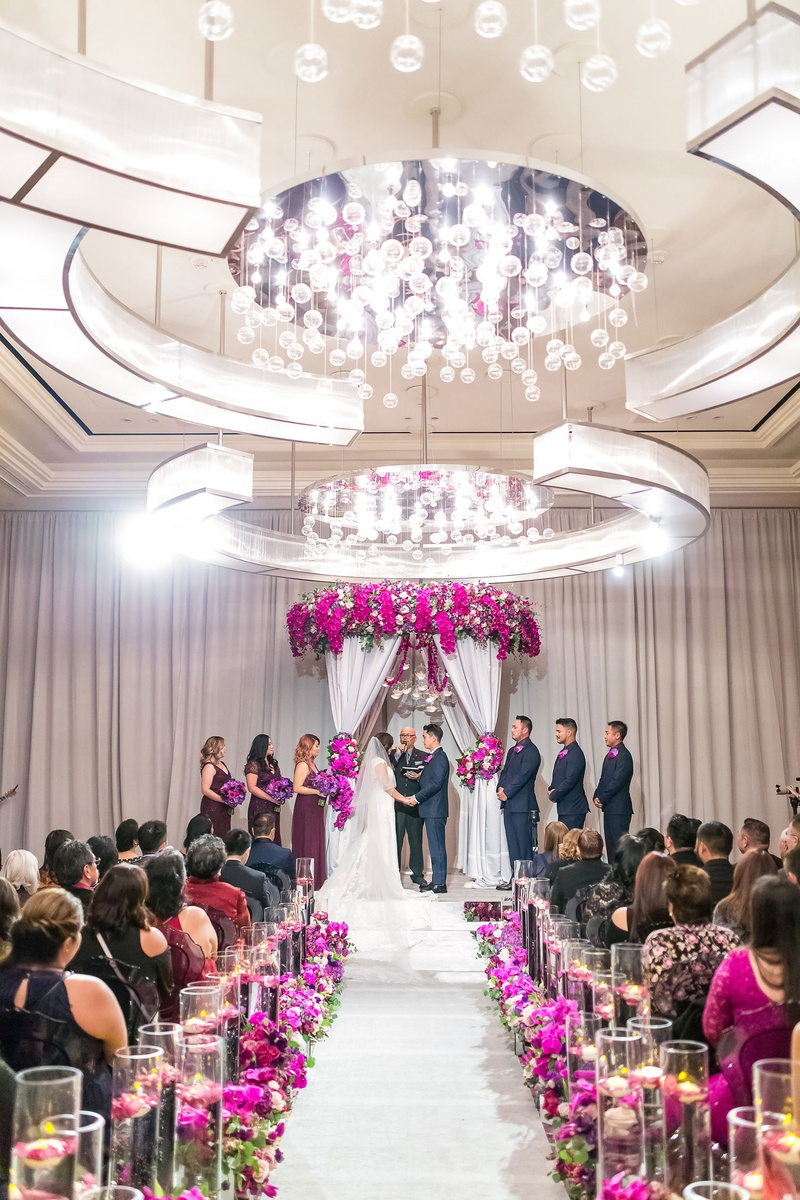 elegant las vegas wedding ceremony, fuchsia flowers, mirrored details, floating candles