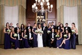 wedding party groom and groomsmen in tuxedos bridesmaids in navy blue floor length gowns chicago