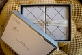 Wedding invitation front of box with ribbon and brooch detail