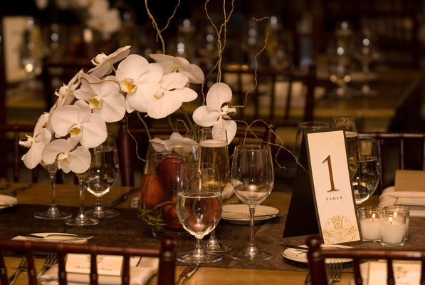 Rustic wedding reception orchid centerpiece