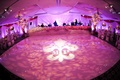 Monogram wedding dance floor with pink lighting