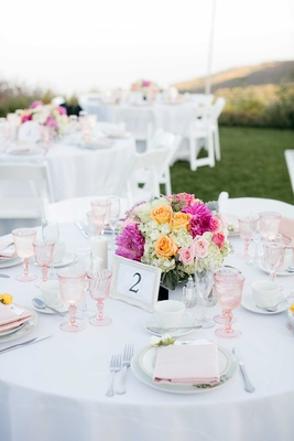 pink wineglasses, orange roses, pastel table setting