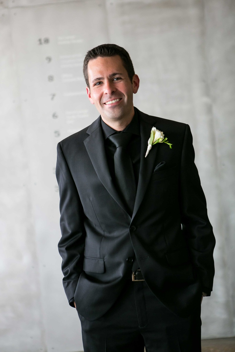 Grooms & Groomsmen Photos - Groom Smiling in All-Black Tuxedo ...