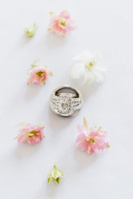 engagement ring oval diamond halo with diamond band inside men's groom ring pink white flowers