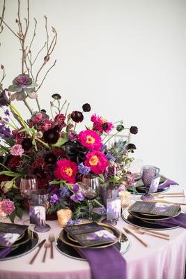 Wedding centerpiece with pink flowers dark purple flower ranunculus rose orchid branches