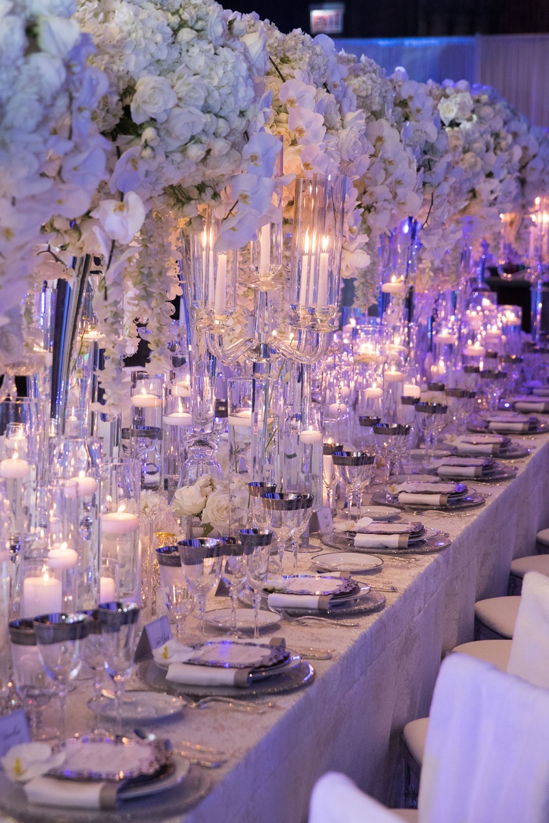 Wedding reception long king's table white orchid rose flowers silver charger glassware floating
