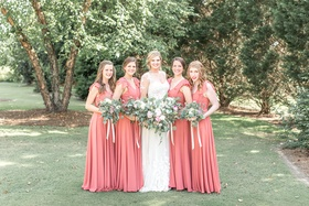 Bride in lace illusion long sleeve wedding dress bridesmaids in long pink red bridesmaid dresses