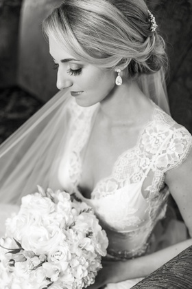 Black and white photo of blonde bride in lace wedding dress