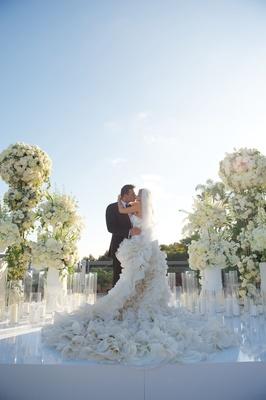 Joanna Krupa and Romain Zago kiss at wedding ceremony