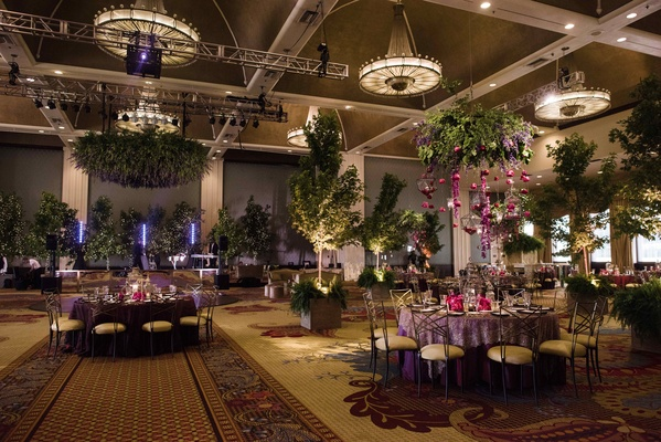 magical, enchanting, greenery for reception with verdant centerpieces suspended greenery and trees