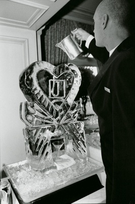 ice sculpture shaped like heart serves cocktails