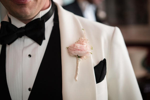 light pink boutonniere single flower rose white black tux modern wedding details groom