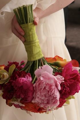 Fuchsia and orange flowers for bride