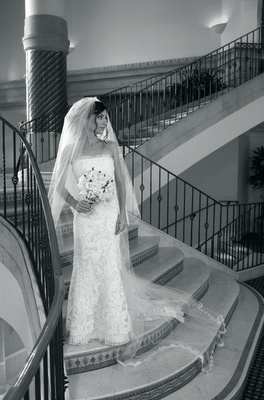 Black and white photo of bride on stairs