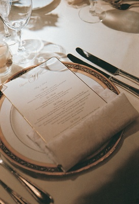 Golden plate and menu card at place setting