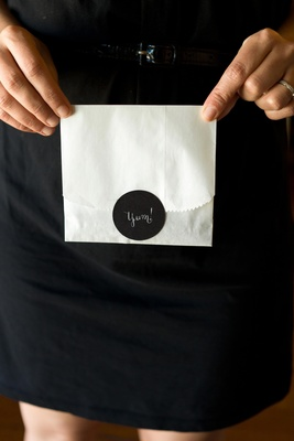 White to-go bag with black sticker
