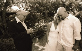 Sepia tone image of outdoor wedding blessing in Montecito