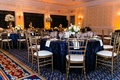 Blue and gold wedding reception with sequin tablecloths