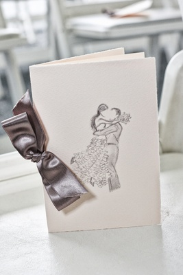 Ceremony program with hand drawn sketch of bride and groom