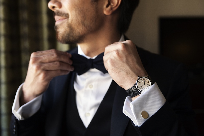 Man wearing tuxedo and bow tie with cuff links