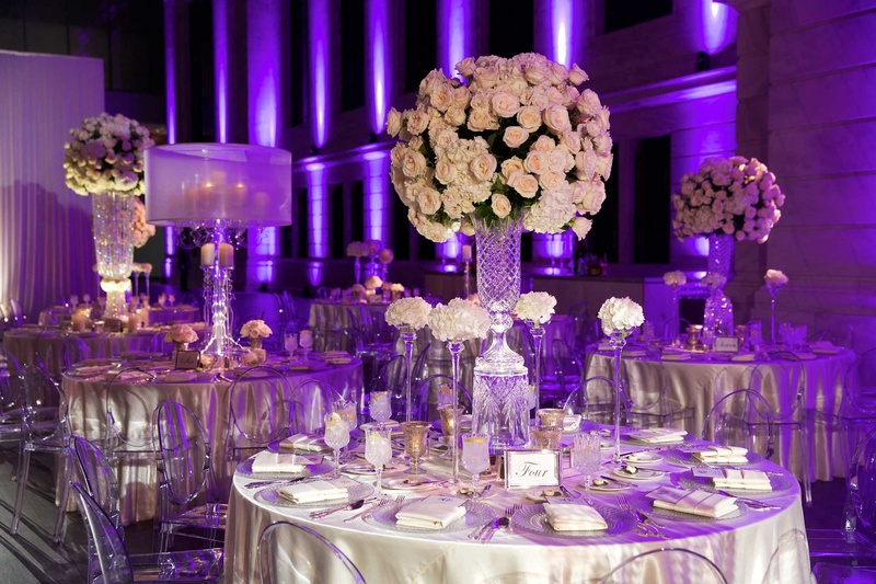 Reception dcor photos classic reception with purple lighting round reception table with tall flower arrangement ivory rose and hydrangea with ghost chairs junglespirit Image collections