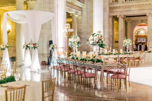 wedding reception heatherlily flowers pink velvet chairs gold chairs tall centerpiece mirror table
