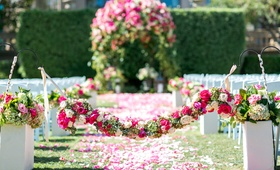 green hydrangea, hot pink rose, white rose flower garland over flower petal aisle Langham Pasadena