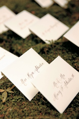 Ivory seating card envelopes on moss