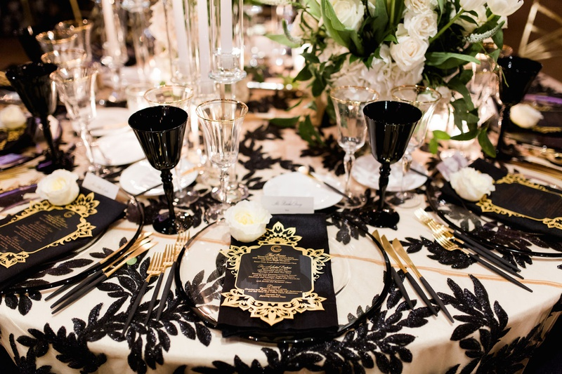 wedding reception black white sequins black gold silverware flatware black goblet wine glass luxe
