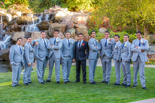 Indian groom with nine friends in grey suits