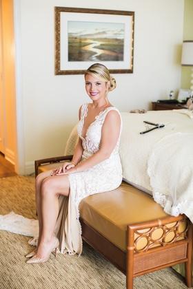 bride in lace alon livne shows off slit in dress sitting at
