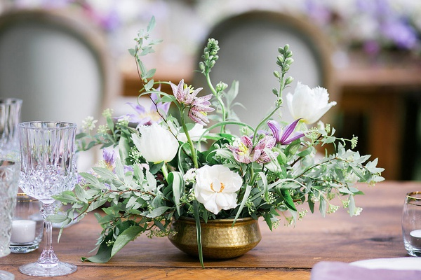wedding reception wood table gold vase vessel bowl white flower purple flowers greenery cut crystal