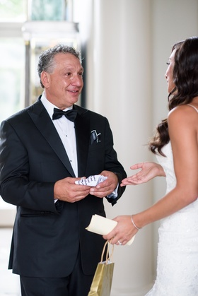 father of the bride cries as bride reads letter and gives handkerchief gift