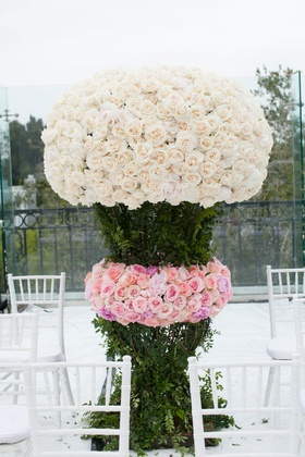 Tall wedding ceremony flower arrangement greenery pink roses and white roses ceremony seating