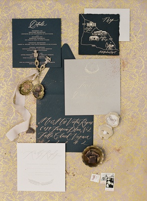destination wedding invitation suite black card stock with gold calligraphy map and monogram