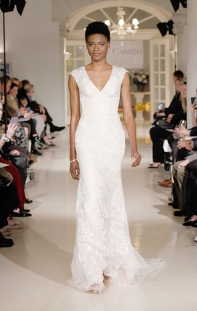 Oleg Cassini Spring 2019 collection tulle gown with plunging v neckline empire waist and appliques