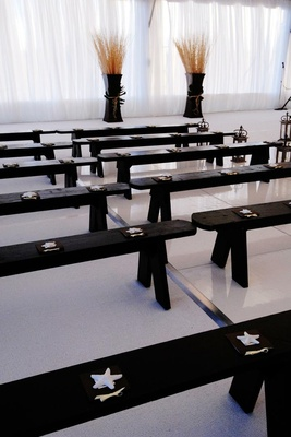 Tented wedding ceremony bench seating